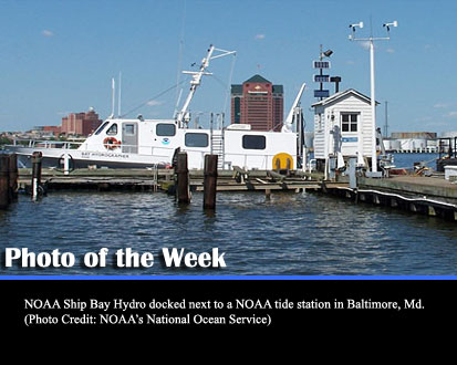 NOAA Ship Bay Hydro docked next to a NOAA tide station in Baltimore, Md. (Photo Credit: NOAA's National Ocean Service)